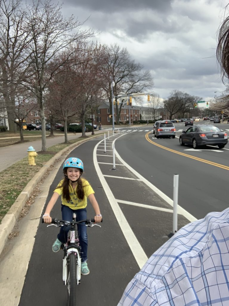 Child riding on a bike in the Quincy Street protected bike lane in Arlington, Virginia